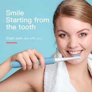 Электрическая зубная щетка (ультразвуковая), в приложении