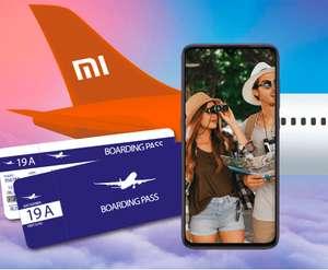 Билеты на самолет в обе стороны за покупку Xiaomi Mi 9